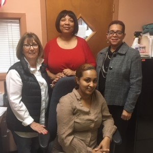 CAPTION: (Left to right) Marianna DeVincentis, grant writer; Susan Moore, Family Self-Sufficiency coordinator; Peggy Wade,  acting director, Section 8 Rental Assistance Program; (seated) Cristina Mateo, assistant housing manager.